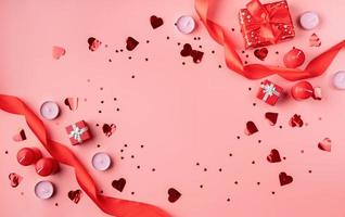Valentines Day background with candles, gifts, hearts and confetti photo