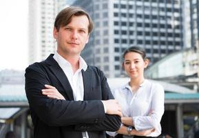 Portrait team of businessman and woman on building office background. photo