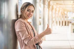 Business woman showing thumbs up. photo