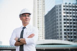 Portrait of senior civil engineer doing thinking photo