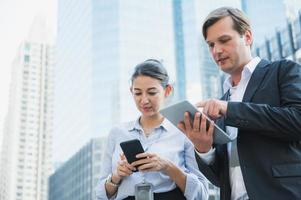 Portrait of businessman and woman using tablet photo