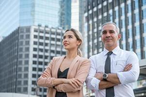 Smiling face of pretty business woman and senior businessman photo
