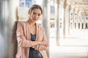 Portrait of smiling pretty young business woman photo