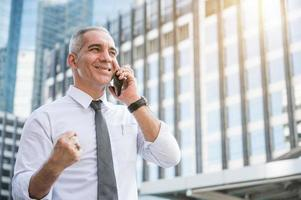 Portrait of senior businessman talking on phone photo