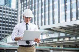 Civil engineering using laptop while working photo