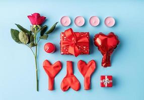 Valentines Day knolling objects decorated on blue background photo
