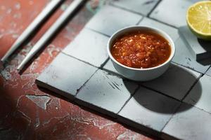 Delicious meal with sambal assortment photo