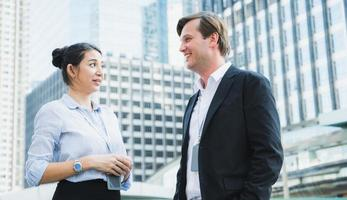 Business people man and woman standing and talking photo