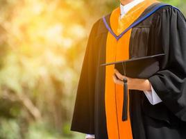 Close up Graduate holding a hat. success education in University photo