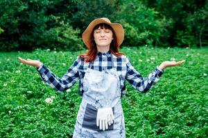 Woman meditating in a garden photo