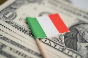 Italy flag on US America dollar banknotes money, finance concept. photo