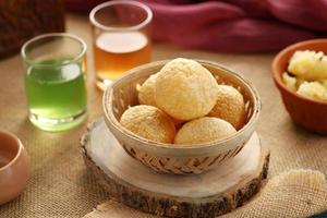 Indian Food Snacks Gol Gappe or Pani Puri or Puchka in a Wooden photo