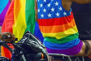 Man wears a T-shirt with the LGBTQ flag with LOVE WINS written on it. photo