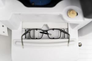 Glasses with black frames arrangement photo