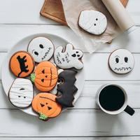 Preparation for Halloween. Coffee and scary gingerbread cookies. photo