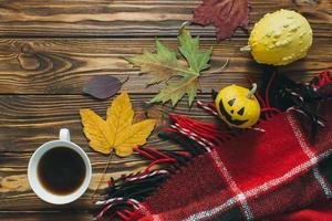 Autumn decor, pumpkins, plaid and leaf photo