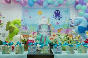Cake table overview decorated with the seabed theme. photo