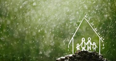 Family in the house in the rain Insurance concept photo