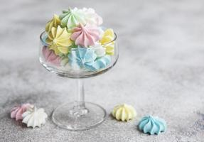 Small colorful meringues in the glass photo