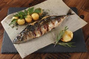 Fried mackerel fish stuffed with lemon. photo