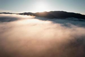 Morning fog in the mountains from above photo