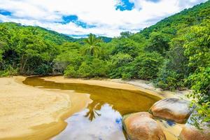 Mangrove and Pouso beach lagoon tropical island Ilha Grande Brazil. photo