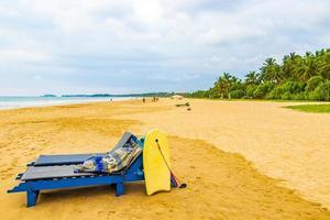 Blue sun loungers in Bentota Beach on Sri Lanka. photo