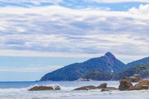 Rocks waves Praia Lopes Mendes beach Ilha Grande island Brazil. photo