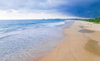 Dark clouds storm above landscape panorama Bentota Beach Sri Lanka. photo