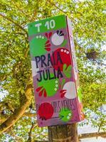 Colorful welcome sign Praia da Julia Beach Ilha Grande Brazil. photo