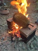 Select Focus, durian is placed over a charcoal stove that is heated to photo