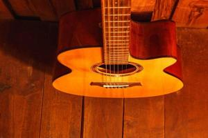 Classical guitar on wooden background photo