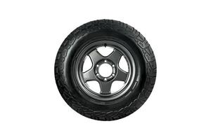 All terrain tire  with alloy wheel isolated on white background. photo