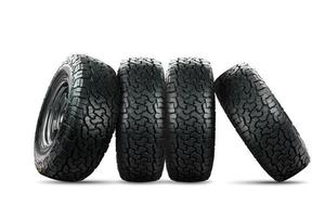 Set of 4 wheels car tires designed for use in all road conditions. photo