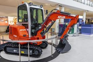 Bremen, Germany, 2021 - Orange Atlas excavator in the Bremen Airport photo