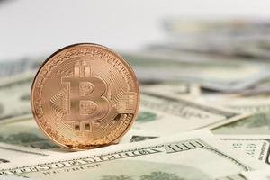 Copper Bitcoin top dollar bills. Resolution and high quality beautiful photo