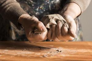 Front view woman shaping clay. Resolution and high quality beautiful photo