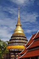 Golden Thai pagoda in natural light photo
