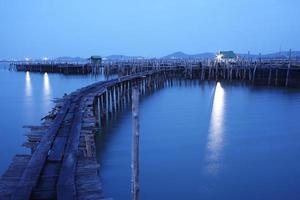 Fish farm on the sea in the night photo