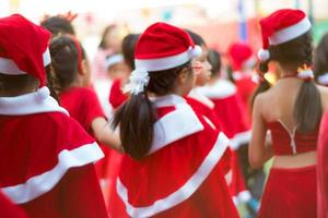 Girls in red theme costume in Christmas party of elementary school photo