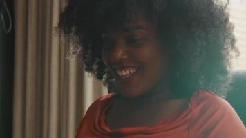 Woman having video call smiling