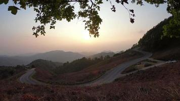 sunrise or sunset with beautiful road and mountain layer video