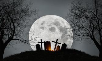 Fondo de halloween de un cementerio con luna llena foto