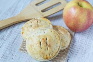 Apple Hand Pies With Spatula Close Up photo