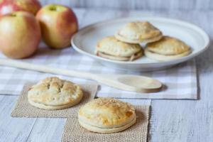 Red Apples And Hand Pies with Wood Spoon photo