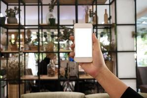 Businesswoman showing blank smart phone screen photo