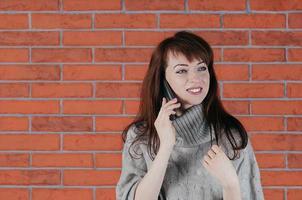 Woman talking on phone photo