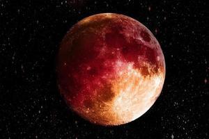 super luna sangrienta azul en el fondo de la galaxia foto
