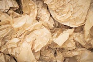 Fondo de textura de papel marrón con arrugas foto