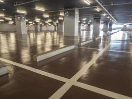 Clean and glossy flooring of the Parking lot in the parking building photo